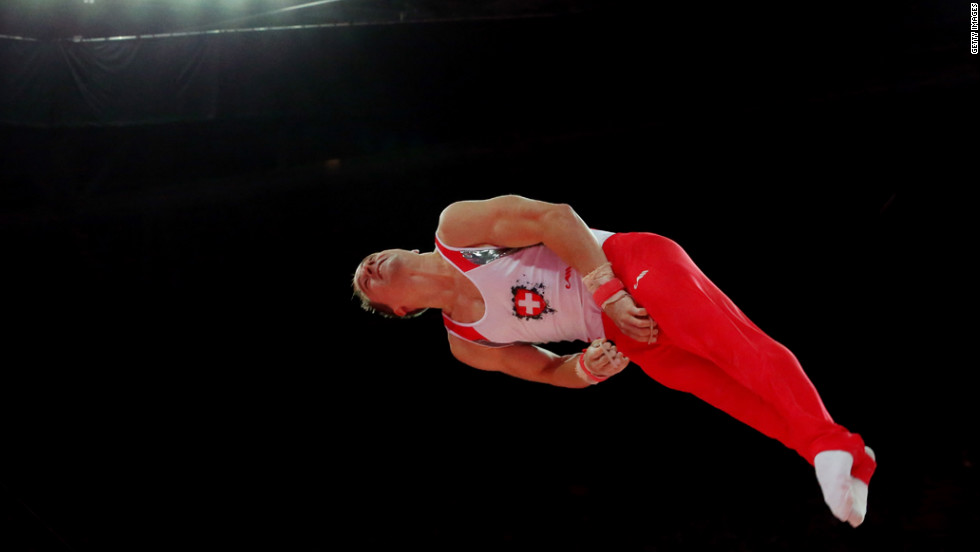 Claudio Capelli of Switzerland competes on the horizontal bar in the men's individual all-around gymnastics final.