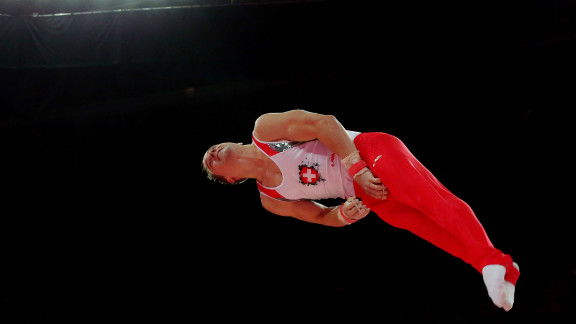 Claudio Capelli of Switzerland competes on the horizontal bar in the men