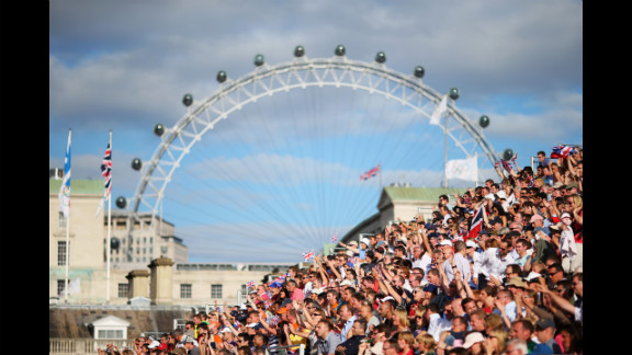The London Eye peers down on the men