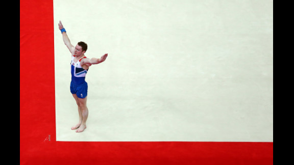 Kristian Thomas of Great Britain performs his floor exercise in the men