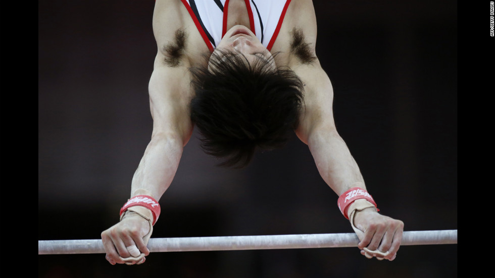 Japan's Kohei Uchimura performs on the horizontal bar during the men's individual all-around competition.