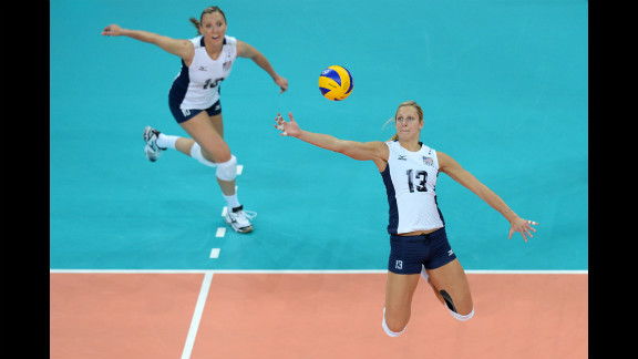 U.S. middle blocker Christa Harmotto, right, spikes during the women