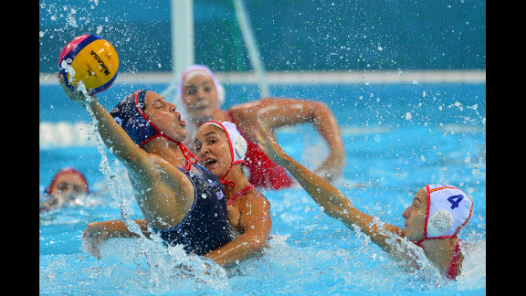 Left to right: Brenda Villa of the United States is challenged by Spain