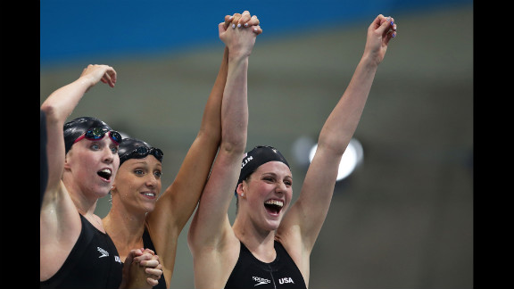 Left to right: Shannon Vreeland, Dana Vollmer and Missy Franklin  celebrate after the U.S. team won gold in the women