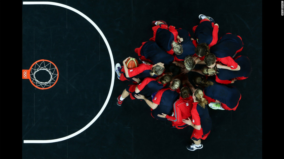 Players from the Czech Republic go into a huddle before starting the second half against Croatia during the women's basketball preliminary round match.