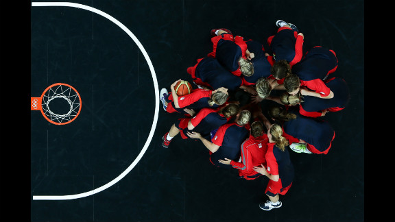 Players from the Czech Republic go into a huddle before starting the second half against Croatia during the women