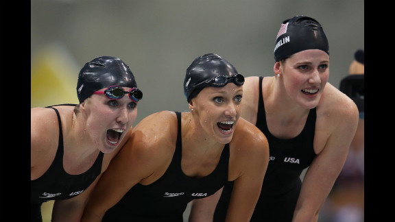 Left to right: Shannon Vreeland, Dana Vollmer and Missy Franklin of the United States encourage teammate Allison Schmitt (not pictured) as they compete in the final of the women