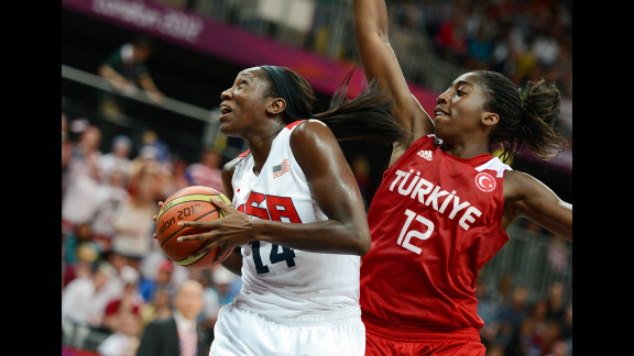 Center for the United States Tina Charles, left, vies with Turkey