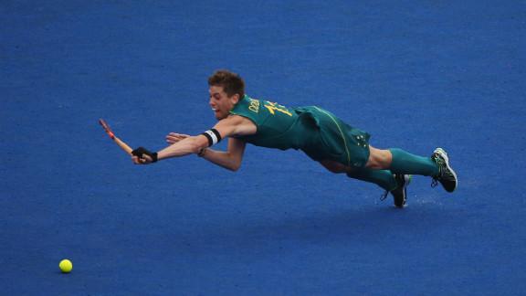 Captain Edward Ockenden of Australia dives for the ball during the men