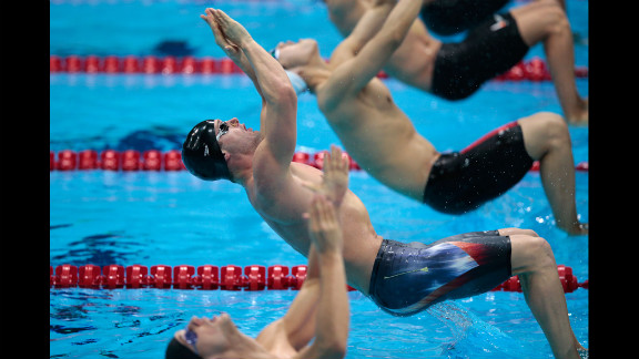 Tyler Clary of the United States pushes off of the block at the start of the second semifinal heat of the men