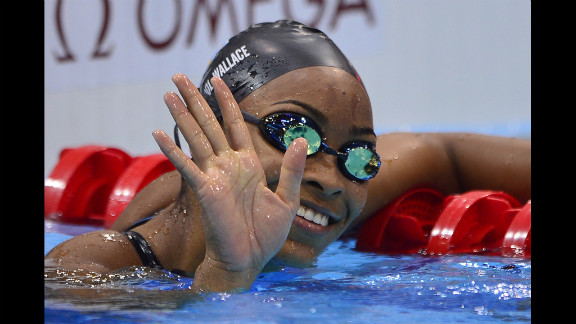 Arianna Vanderpool-Wallace of the Bahamas waves to the crowd after the women
