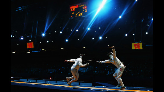 Paris A. Inostroza Budinich of Chile competes against Max Heinzer of Switzerland in the men