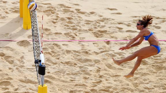 Vasiliki Arvaniti of Greece hits the ball over the net during the women