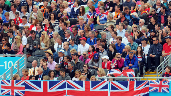 Great Britain fans watch and cheer during the men