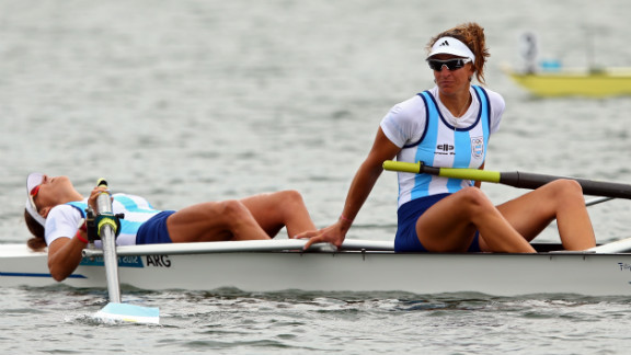 Maria Laura Abalo, left, and Gabriela Best of Argentina look on after finishing the women