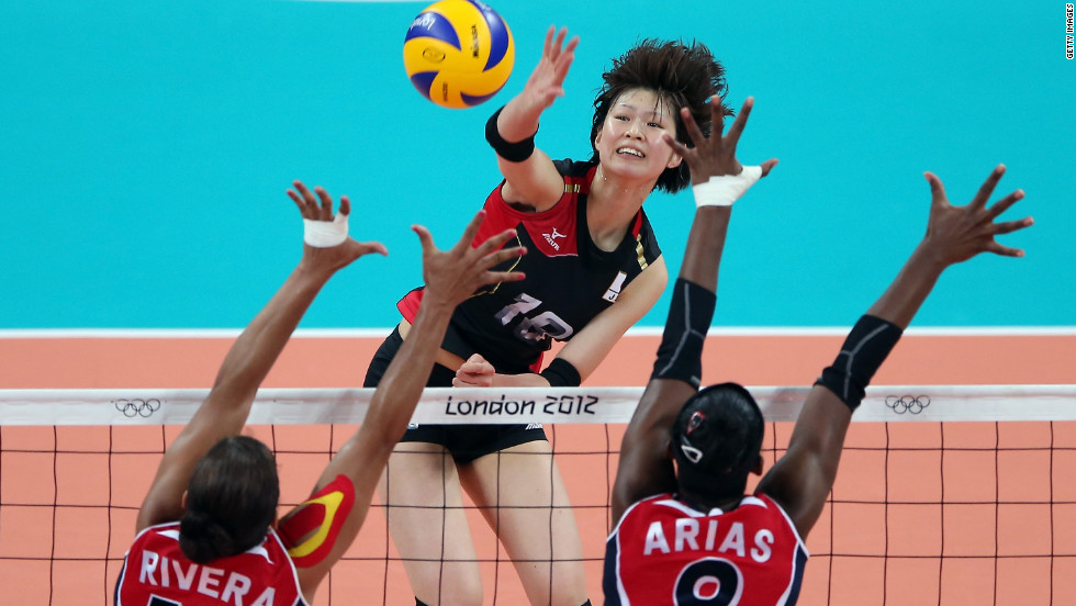 Saori Kimura of Japan spikes the volleyball Wednesday as Prisilla Altagracia Rivera Brens, left, and Candida Estefany Arias Perez of the Dominican Republic try to block.