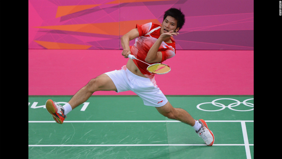 Derek Wong of Singapore returns against Jan O Jorgensen of Denmark during their men's singles badminton match.