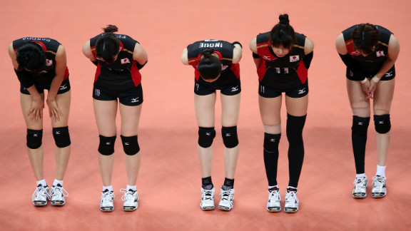Team Japan bows to the fans after beating the Dominican Republic in women