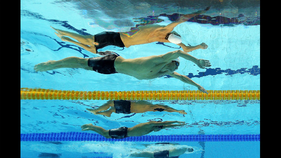 Michael Phelps of the United States, top, competes Wednesday in the men