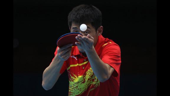 Zhang Jike of China serves during the men