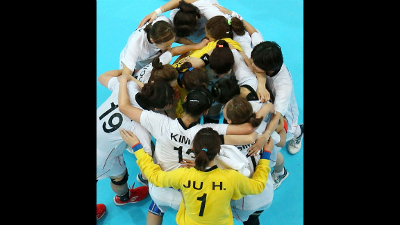 Korean players huddle after tying with Norway in a women