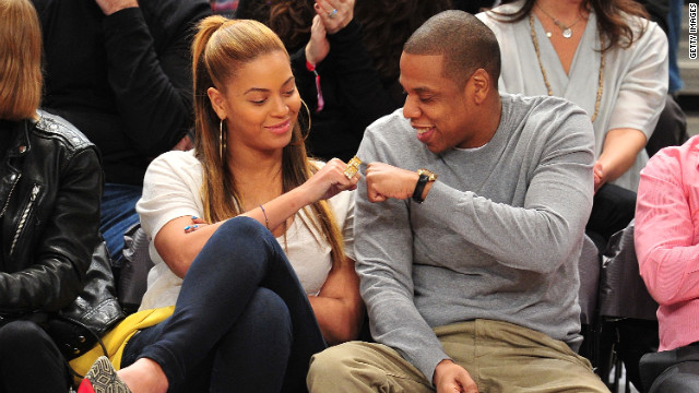 Jay-Z, right, and wife Beyonce celebrate at a New Jersey Nets game February 20, 2012 in New York City.