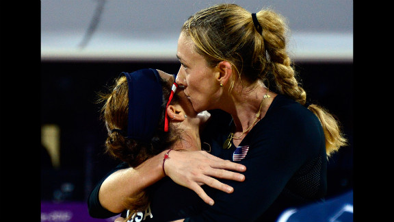Misty May-Treanor and Kerri Walsh of the United States celebrate their win against Austria