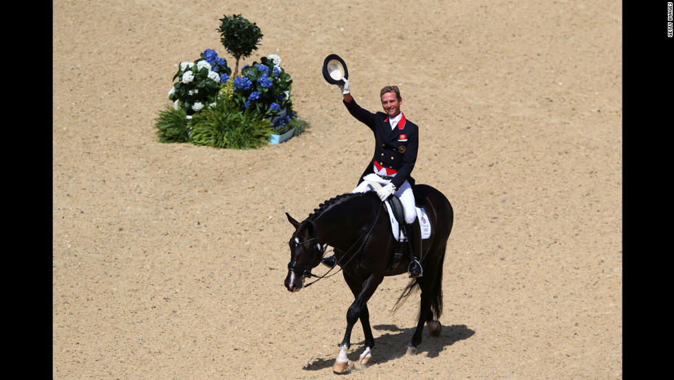 Britain's Carl Hester rides Utopia in the dressage grand prix at Greenwich Park in London.