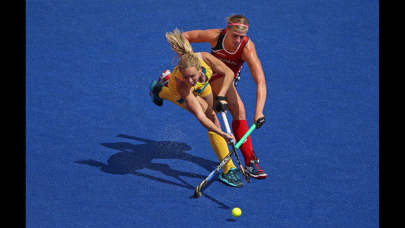 Katelyn Falgowski, right, of the United States goes after the ball with Fiona Boyce of Australia during a women
