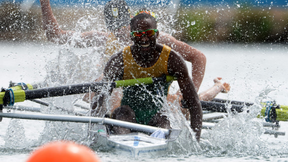 Sizwe Ndlovu of South Africa celebrates after he and his team won the gold in the lightweight men