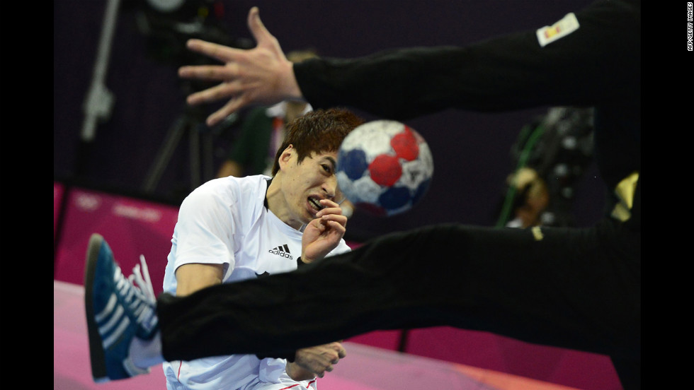 South Korea's Jeong Han shoots during the men's preliminary  handball match against Spain.
