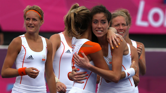 Naomi van As of the Netherlands hugs teammate Eva de Goede after their team defeated China in a women