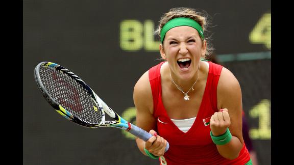 Victoria Azarenka of Belarus celebrates after winning in the women