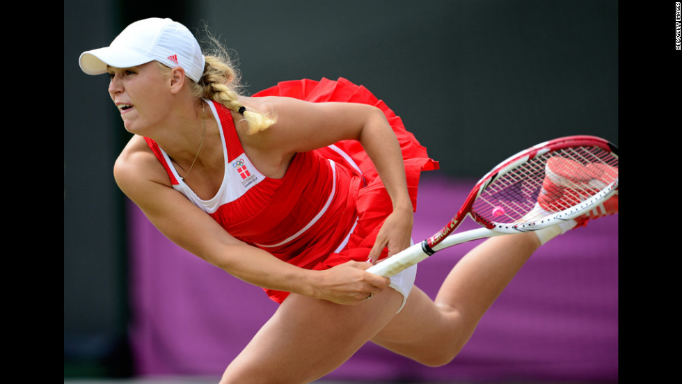 Denmark's Caroline Wozniacki serves to Serena Williams of the United States during the women's singles tennis quarterfinals.