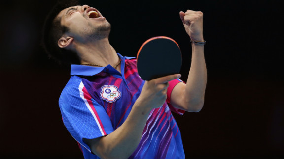 Chih-Yuan Chuang of Taiwan celebrates a point during the men