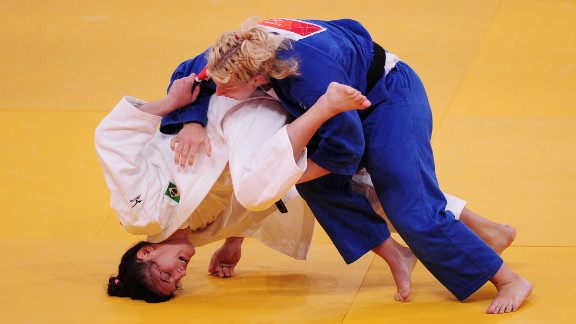 Mayra Aguiar of Brazil, in white, and Kayla Harrison of the United States compete in the women