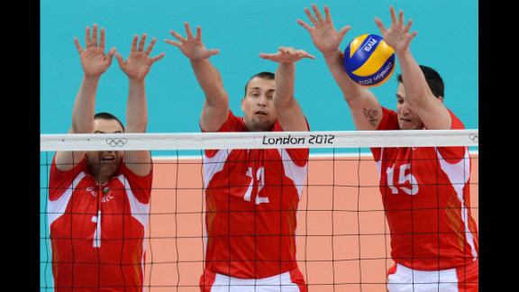 Bulgarian volleyball players, from left, Georgi Bratoev, Viktor Yosifov and Todor Aleksiev attempt to set during a preliminary match against Australia.