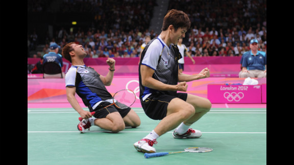 Yong Dae Lee, right, and Jae Sung Chung of South Korea celebrate their win over Indonesian opponents in the men