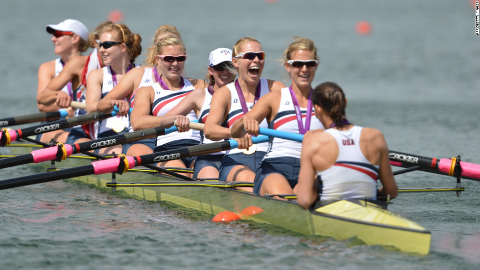 The U.S. team poses on their boat after winning their gold medals.