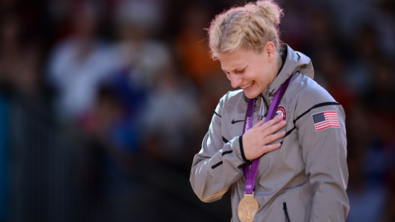 American Kayla Harrison reacts on the podium after winning the gold medal in women