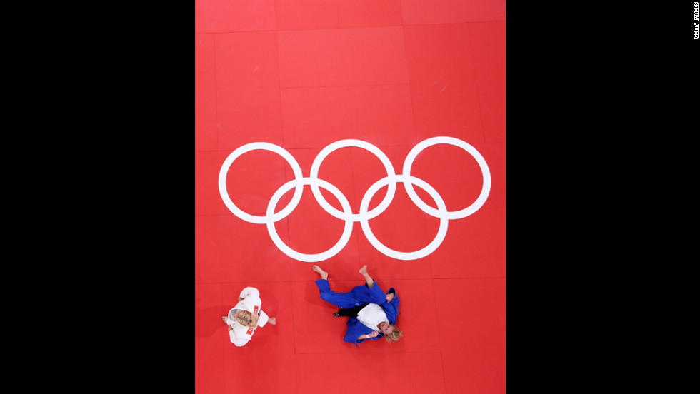 American Kayla Harrison, in white, and Gemma Gibbons of Britain compete in women's judo on Thursday.