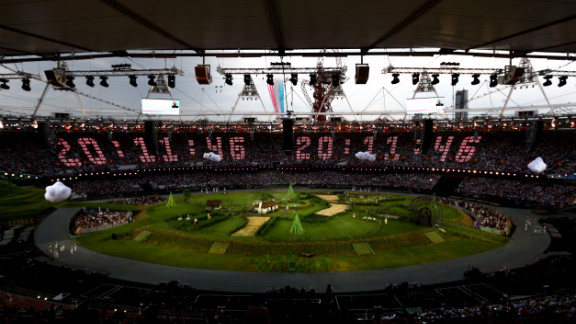 """The countdown to the start of the opening ceremony is projected across the stands while the Royal Air Force aerobatic team, the Red Arrows, flies over the Olympic Stadium. The opening ceremony of the London 2012 Olympic Games was held on Friday, July 27. Check out photos from the<a href=""""http://www.cnn.com/2012/08/12/world/gallery/olympic-closing-ceremony/index.html"""" target=""""_blank""""> closing ceremony.</a>"""