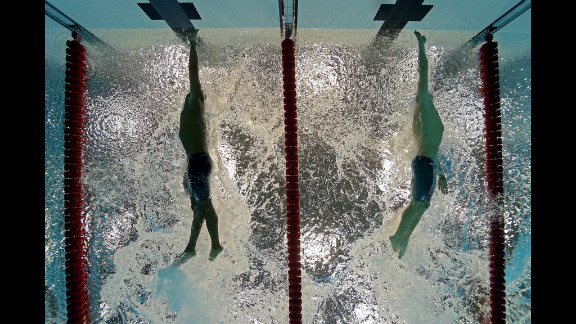 Cullen Jones, left, of the United States and Cesar Cielo of Brazil touch the wall at the finish the men