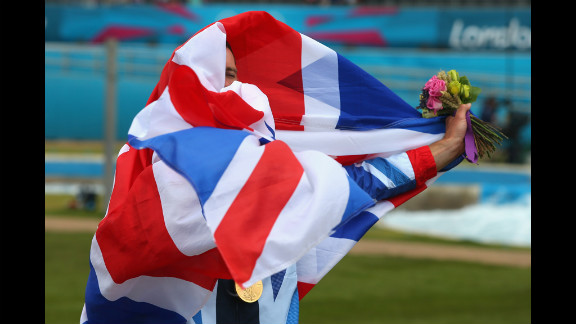 Gold medalist Etienne Stott of Great Britain celebrates after the medal ceremony for the men
