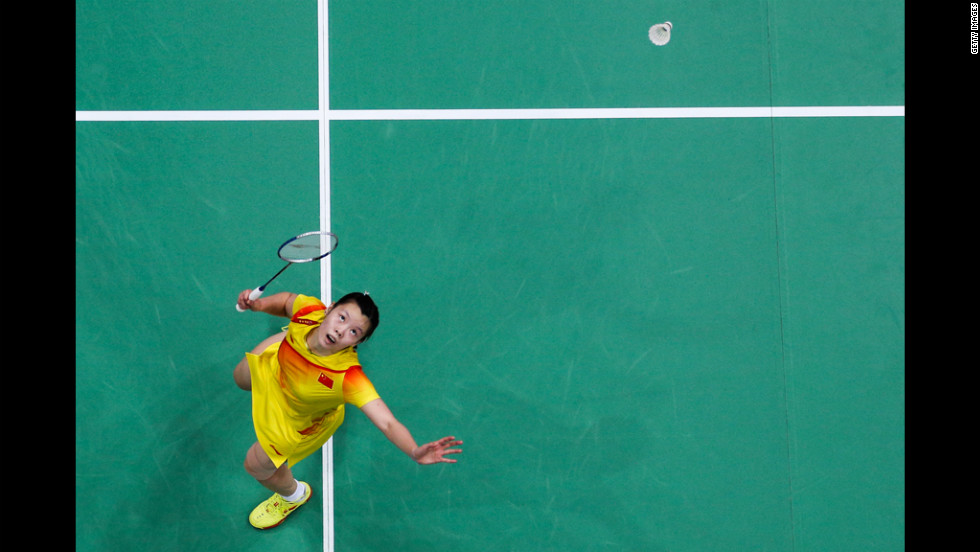 China's Xuerui Li returns a shot against Pui Yin Yip of Hong Kong in their women's singles badminton quarter final.