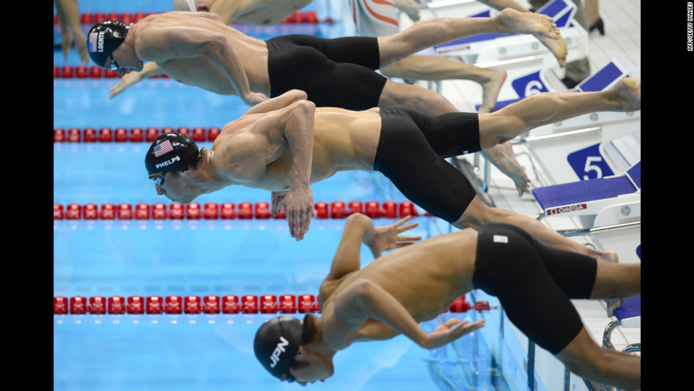 Phelps, center, dives next to U.S. swimmer Ryan Lochte, top, and Japan's Kosuke Hagino at the start of the 200-meter individual medley.