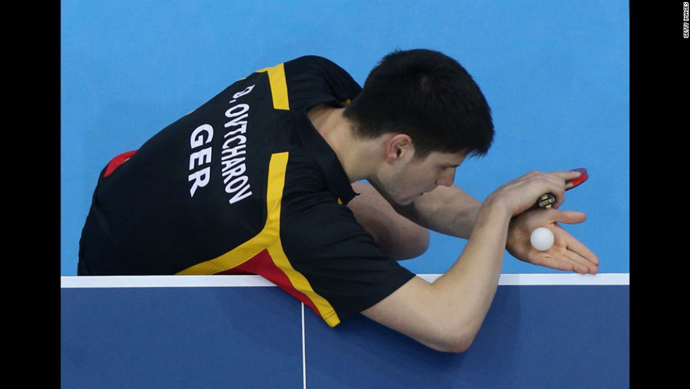 Germany's Dimitrij Ovtcharov addresses the ball during the bronze-medal table tennis match. The ball did not respond, remembering better days with former Detroit Tigers pitcher Mark Fidrych.