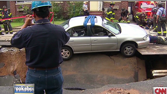 Sinkhole almost swallows car