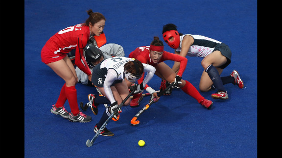 South Korea, in red, and Japan do battle during the women