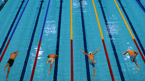 Competitors dive into the pool at the start of the men